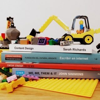 Web writing books buried under Lego